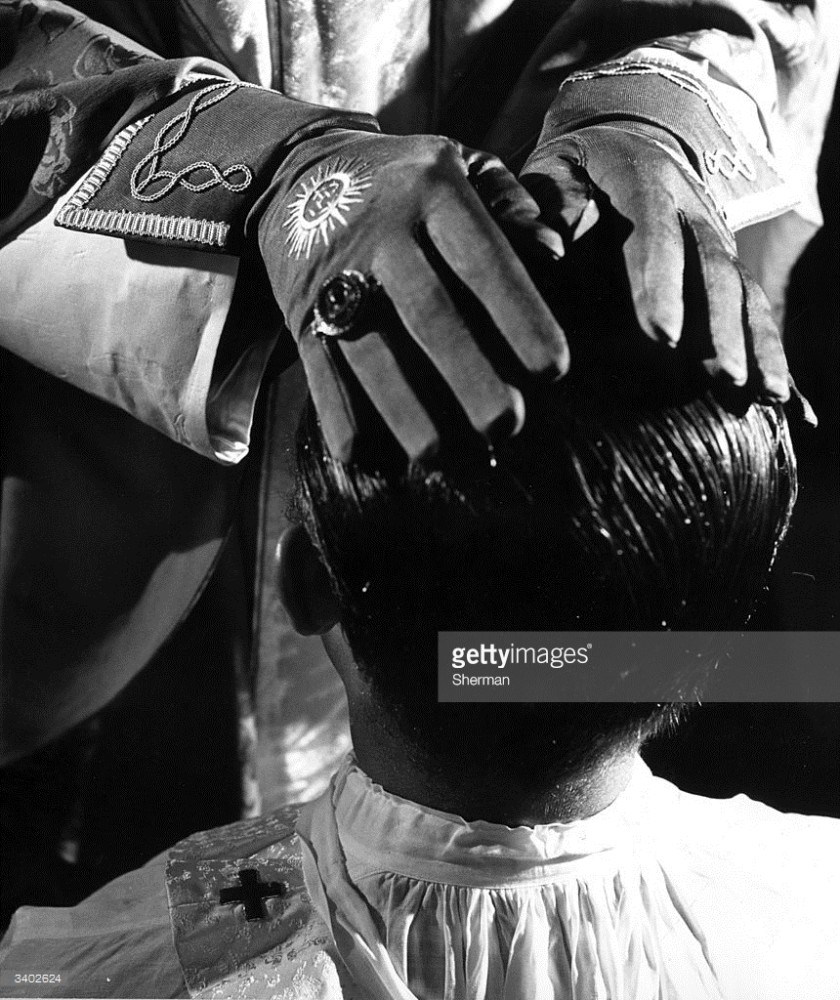 3402624-circa-1955-during-an-ordination-rite-the-gettyimages